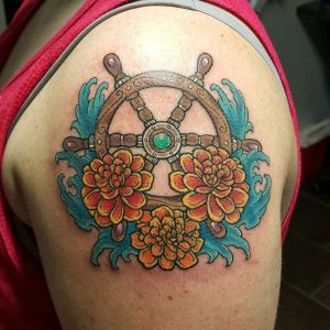 Tatuaggio tattoo mare timone
