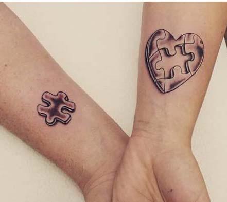 Tatuaggio Tattoo Madre Figlia Puzzle