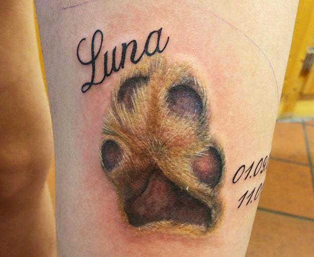 Tatuaggio Tattoo Zampa Cane Nome