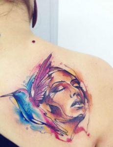 Tatuaggio tattoo acquerello viso volto